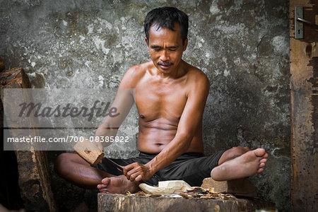 Woodcarver, Petulu near Ubud, Bali, Indonesia