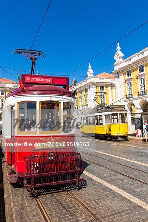 Old trams in Praca do Comercio, Baixa District, Lisbon, Portugal