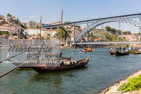 Traditional port wine boats on the Douro River in front of the old city, Cais da Ribeira and Ponte de Dom Luis I. Bridge, Cais da Gaia, UNESCO World Heritage Site, Porto, Portugal