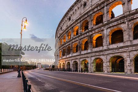 Illuminated Colosseum at dawn, UNESCO World Heritage Site, Rome, Italy