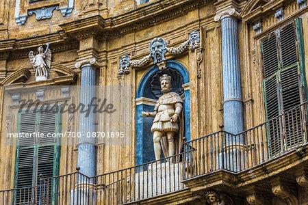 Statue of Philip IV on the North building at Piazza Vigliena (Quattro Canti) on Corso Vittorio Emanuele in the historic center of Palermo in Sicily, Italy