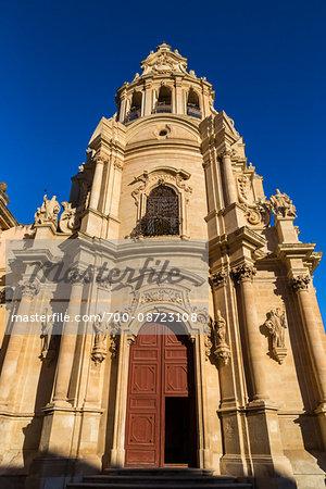 Orante, stone facade of the Baroque San Giuseppe Church in Ragusa in Sicily, Italy