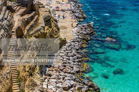 Stone staircase along the coastal cliffs at a resort in Santa Cesarea Terme in Puglia, Italy