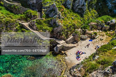 Stone staircase and small beach at the coastal town of Gagliano del Capo in Puglia, Italy