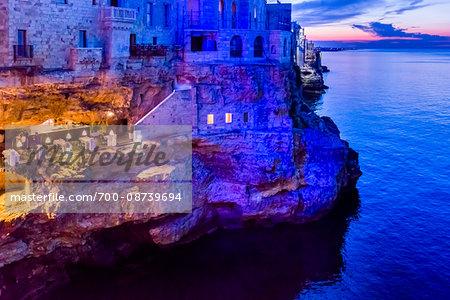 Cliff Restaurant Grotta Palazzese at Dusk in Polignano a Mare, Puglia, Italy
