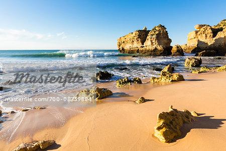 Rocks in Sand at Praia de Sao Rafael, Albufeira, Algarve, Portugal
