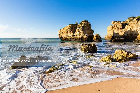 Rocks in Surf at Praia de Sao Rafael, Albufeira, Algarve, Portugal