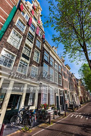 Traditional buildings line Geldersekade in Chinatown in Amsterdam, Holland