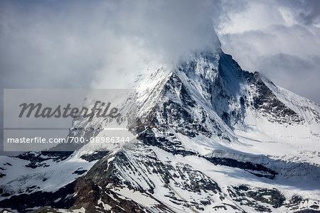Mountain mist partially covering the Matterhorn summit at Zermatt in Switzerland