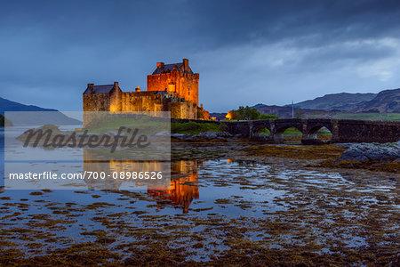 Eilean Donan Castle illuminated at dusk near Kyle of Lochalsh in Scotland, United Kingdom