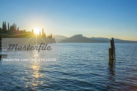 Sunrise on Lake Garda at Punta San Vigilio in Garda in Verona Province, Veneto, Italy
