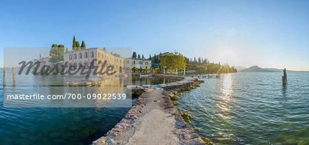 Locanda San Vigilio with harbor at sunrise in Punta San Vigilio in Garda on Lake Garda in Veneto, Italy