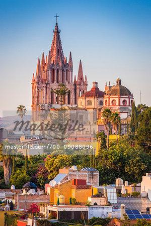 The intircate towers of the Parroquia de San Miguel Arcangel overlooking the El Jardin in San Miguel de Allende, Mexico