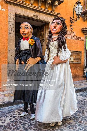 Papier-mache figures of bride and groom during a Mexican wedding procession in San Miguel de Allende, Mexico