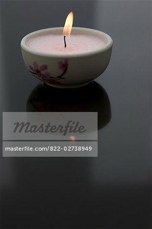 Burning pink tea light