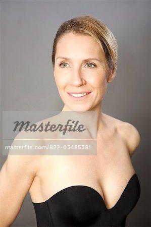 Woman wearing strapless black bodice