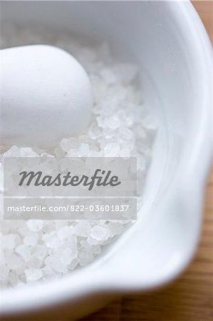 Mortar and Pestle Filled with Rock Salt