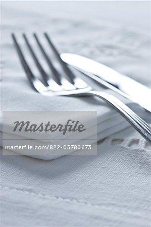 Knife and Fork on Cloth Napkin