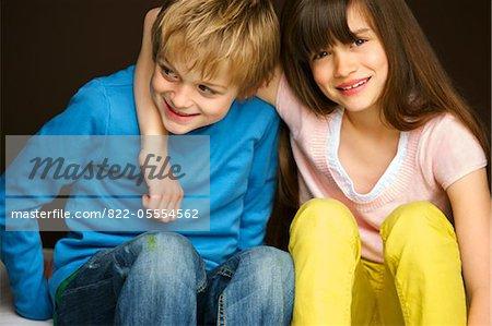 Smiling Boy and Girl Hugging