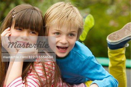 Boy and Girl Lying Outdoors