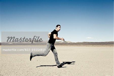 Man Running in Desert Landscape