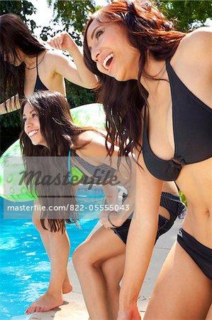 Smiling Women By Swimming Pool