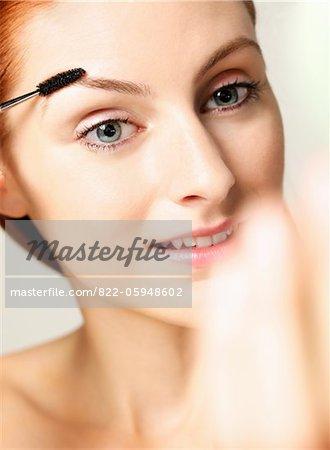 Woman Using Eyebrow Brush
