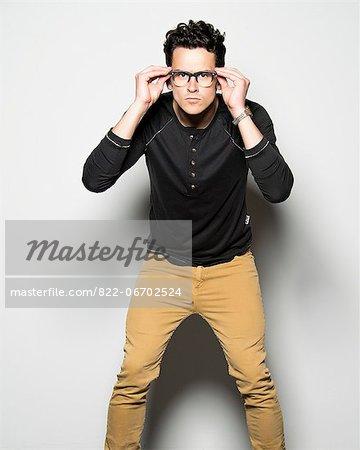 Man Adjusting Eyeglasses