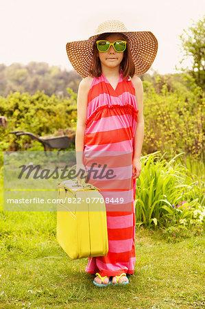 Girl Wearing Oversize Dress Holding Suitcase