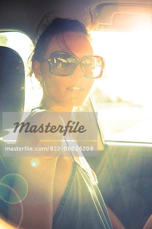 Woman Inside Car at Sunset