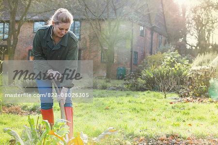 Woman Gardener Digging with Spade