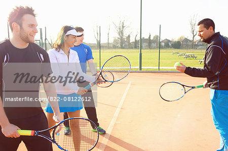 Tennis Instructor Teaching Class