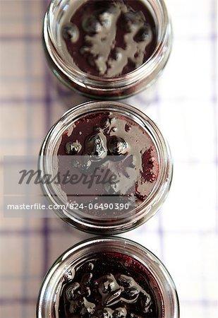 Overhead view of jars of blackcurrant jam - step shot, blackcurrant jam