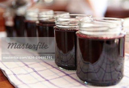 Side view of blackcurrant jam in jars - step shot, blackcurrant jam