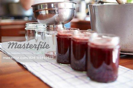Funneling jam into jars - jam making - step shot