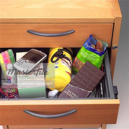 Office desk drawer full of snacks