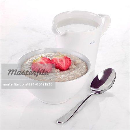 Porridge with Strawberries and a jug of Milk