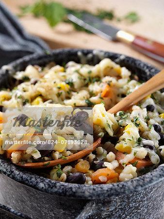 Vegetarian casserole with pearl barley, bulgar wheat, black beans, carrots and corn. Vegan