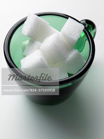 A cup of sugar lumps