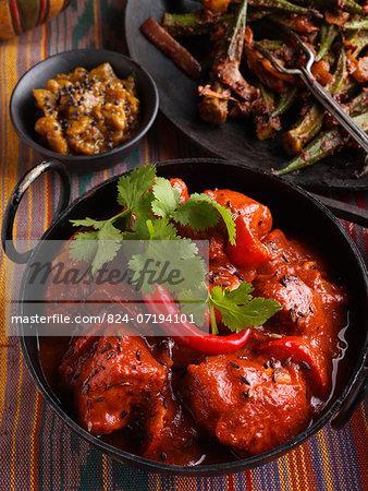 Chicken vindaloo Indian hot curry okra and aubergine chutney