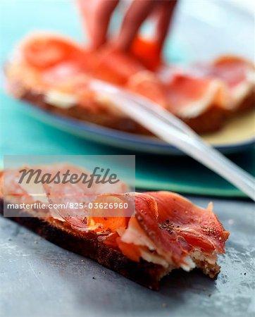 Tomato and ham open sandwich