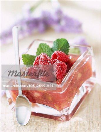 rapsberries on bed of stewed rhubarb