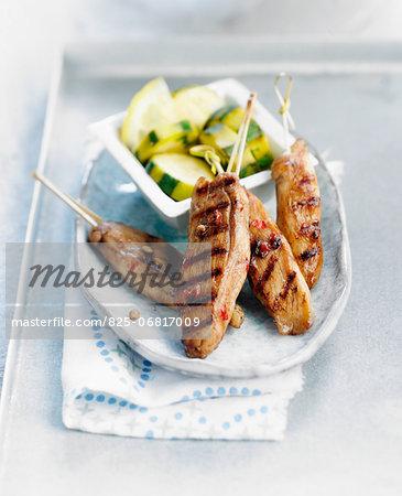 Spicy marinated chicken brochettes,zucchinis with lemon