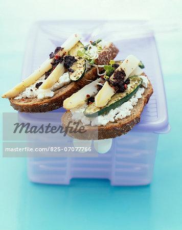 Cream cheese,zucchini,asparagus and tapenade open sandwich