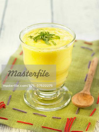 Mango and pine nut cream dessert with fresh mint