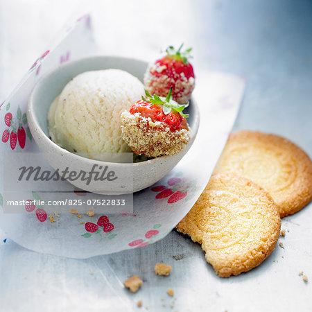 Strawberries coated in crushed Saint-Michel galettes,vanilla ice cream