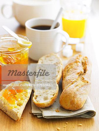 Breakfast with coffee,orange juice ,bread and jam