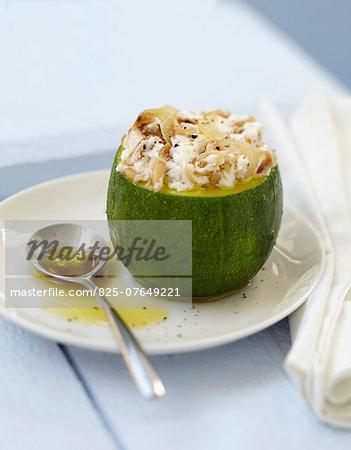 Round zucchini stuffed with goat's cheese and pinenuts