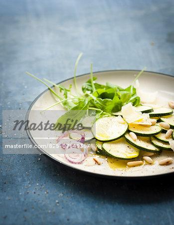 Raw zucchini,parmesan and pinenut salad