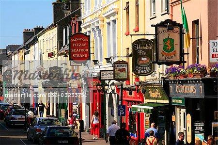 e213981214e42 Killarney,Co Kerry,Ireland;Traditional signs hanging from shopfronts -  Stock Photo